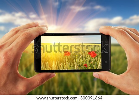 Mobile phone snapping a picture - stock photo