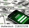 mobile phone with mobile banking screen over dollars background - stock photo
