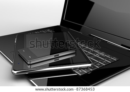 Mobile phone with pad and laptop - stock photo