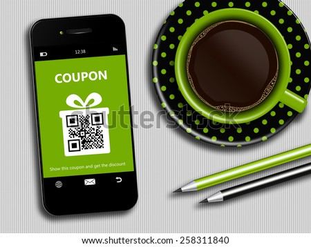mobile phone with spring discount coupon, coffee and office tools lying on desk - stock photo