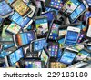 Mobile phones background. Pile of different modern smartphones. 3d - stock photo