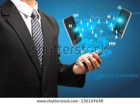 Mobile phones technology business concept, Creative network information process diagram in the hands of businessman - stock photo