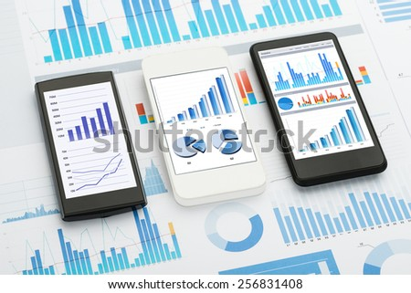 Mobile Phones With  Analytics Graphs And Charts - stock photo