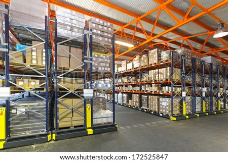 Mobile roller shelving system in distribution warehouse