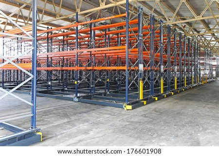 Mobile shelving roller system in distribution warehouse - stock photo