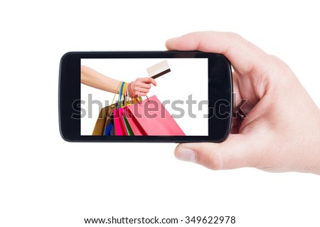 Mobile shopping concept using credit card and smartphone or cellphone - stock photo