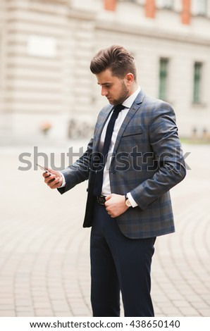 mobile smart  phone in the hands of a businessman