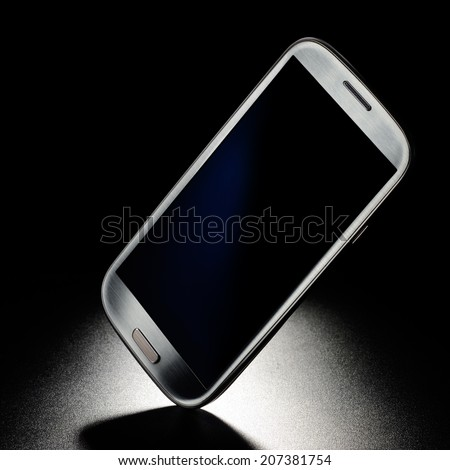 Mobile smart phone on black grained background - stock photo