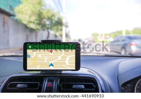 Mobile smart phone using for GPS navigator selective focus shallow depth of fileld road bacground - stock photo