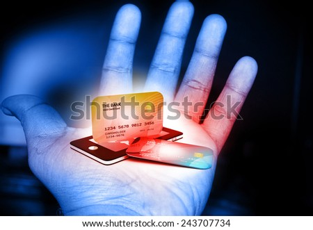 Mobile smart phone with credit card in human hand  - stock photo