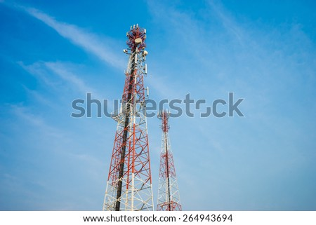 Mobile tower antennas with blue sky background - stock photo