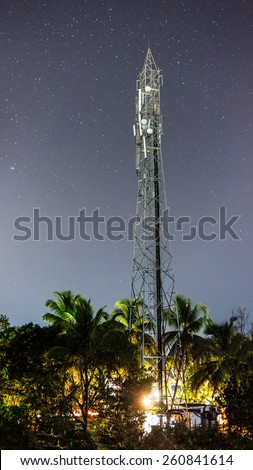 Mobile tower at the night with star treks sky as a background, Goa, India. - stock photo