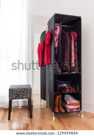 Mobile wardrobe with bright clothing, shoes and accessories. - stock photo