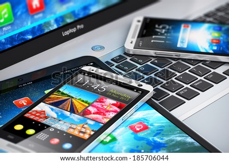 Mobility and modern internet business communication technology concept: laptop or notebook, tablet computer PC and black glossy touchscreen smartphones with color interfaces with icons and buttons - stock photo