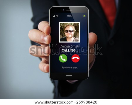 mobility communications concept: businessman hand holding a touch phone receiving a call. 3D generated phone. - stock photo