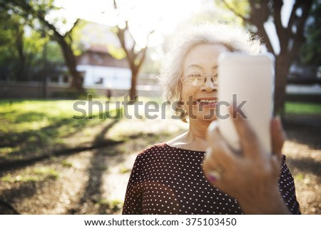 Mobility Senior Adult Online Selfie Concept - stock photo