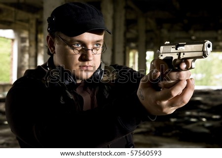 mobster in industrial place - stock photo