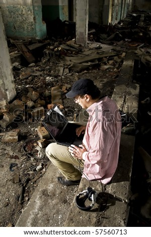 mobster using notebook in industrial place - stock photo
