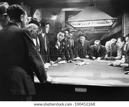 Mobsters meeting around pool table - stock photo