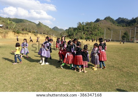 Moc Chau, Vietnam: childrens wear beautiful costumes playing traditional games in the forest on jan 10, 2016. this time is Tet Holiday of H'mong ethnic in Northen Vietnam