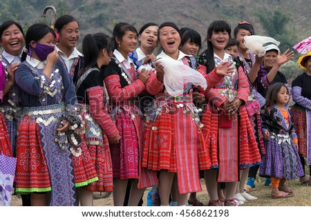 MOC CHAU, VIETNAM, February 9, 2016 the youth groups, ethnic Hmong, highland Moc Chau, wearing traditional costumes, in the spring