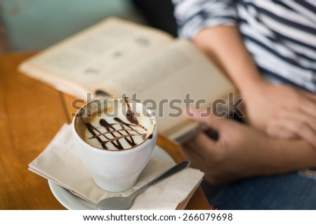 mocha coffee and book - stock photo