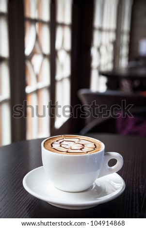mocha coffee drink on a wood table by the window in cafe - stock photo
