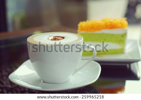 Mocha in white coffee cup and Foythong Cake or Gold Egg Yolks Thread Cake in the Coffee Shop, vintage tone - stock photo