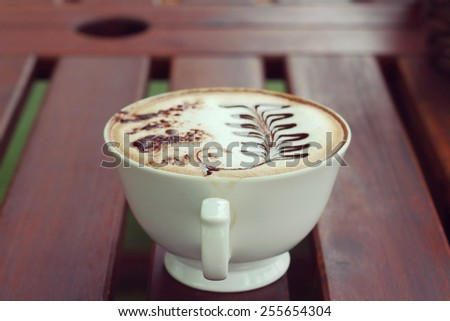 Mocha in white coffee cup in the Coffee Shop, Blurred background and soft focus - stock photo