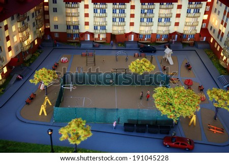 mock town house miniature people - stock photo