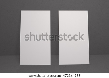 Mock up business card and cover vertical format. White paper card on dark background, for your design and template. Three-dimensional rendering.