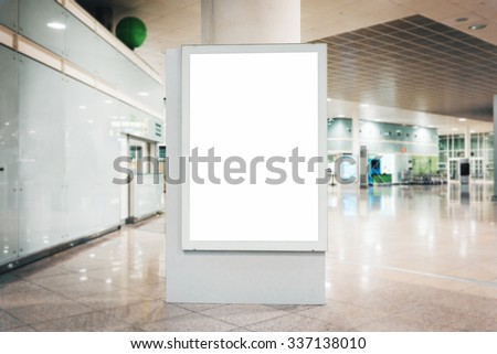 Mock up of blank light box in airport - stock photo
