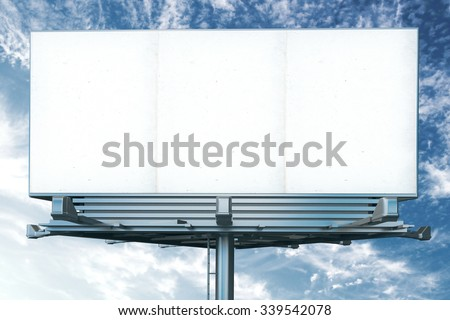 Mock up of blank white billboard on a background of blue sky - stock photo