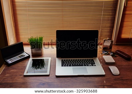 Mock up of business person desktop with luxury accessories and distance work tools, laptop computer and digital tablet with blank copy space for text message or information content, start up concept - stock photo