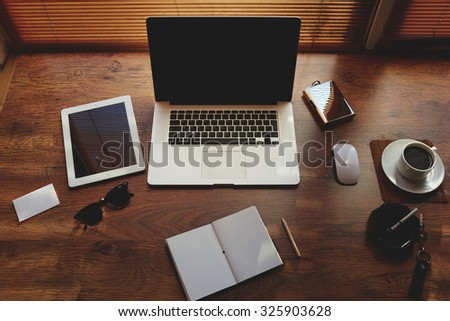 Mock up of hipster workplace with luxury accessories and distance work tools, laptop computer and digital tablet with blank copy space for text message or information content, net book and touch pad - stock photo