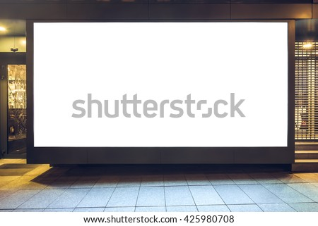 Mock up of store blank street showcase window in a city at night. Front view - stock photo