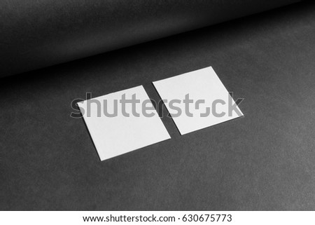 Mockup two square business cards on stock photo edit now 630675773 mock up of the two square business cards are on a black paper reheart Images