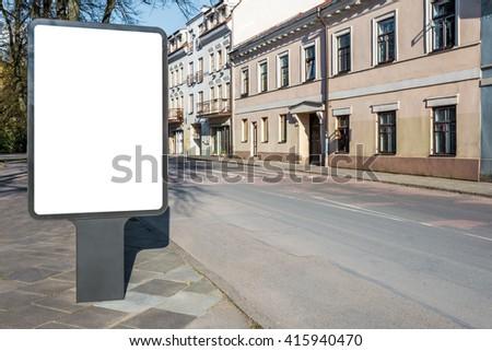 Mock up of vertical street billboard in empty street - stock photo