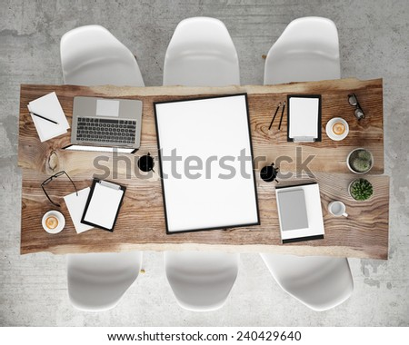 mock up poster frame on meeting conference table with office accessories and laptop computers, hipster interior background, 3D render - stock photo