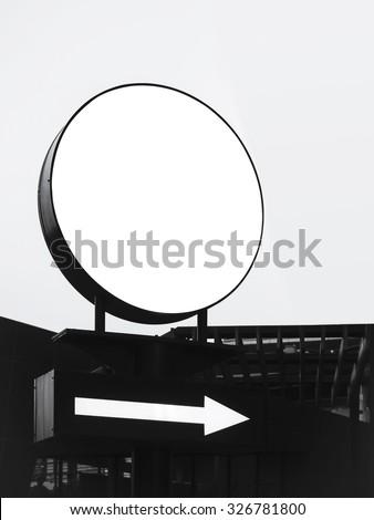 Mock up Signage light box circle shape with arrow direction sign display  - stock photo
