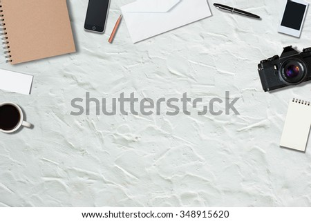 Mock up template of traveling equipment with copy space on white cement floor - stock photo