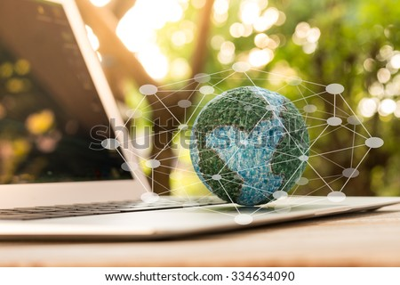 mock up the globe  with digital social media network on keyboard laptop computer in nature background - stock photo