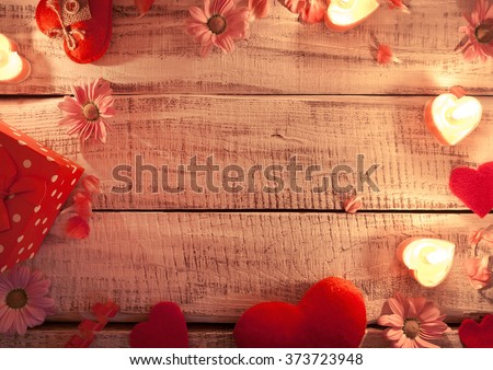 Mock up with candles, flowers and hearts on white rustic wooden background with copy space for text. Valentine's Day and Mother's Day background. Top view. - stock photo