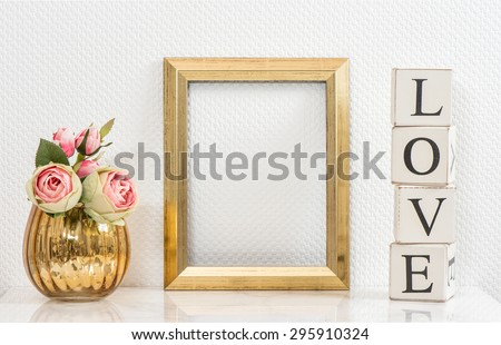 Mock up with golden frame and flowers. Vintage style interior with space for your picture or text. Love concept - stock photo