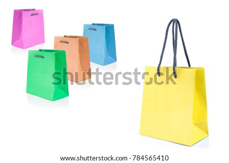 Mock-up with yellow, green, orange, blue and pink paper bags for shopping on white background.