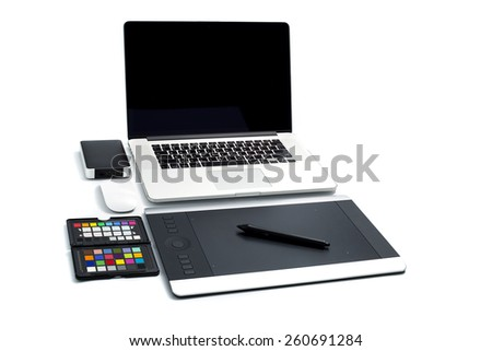 Mock up workspace with computer on home or studio on flat white background. - stock photo