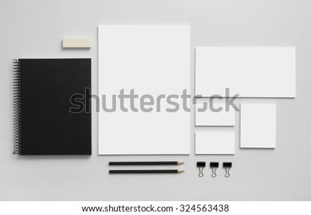 Mockup business brand template on gray background. Set of stationery with a black notepad. - stock photo