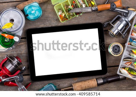 mockup frame fishing tackles and fishing baits in box on wooden board background. Design for adventure sport business - templates, web, poster, card, advertisement. - stock photo