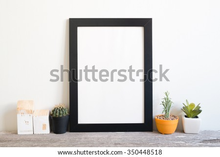 mockup of blank frame poster on wall - stock photo