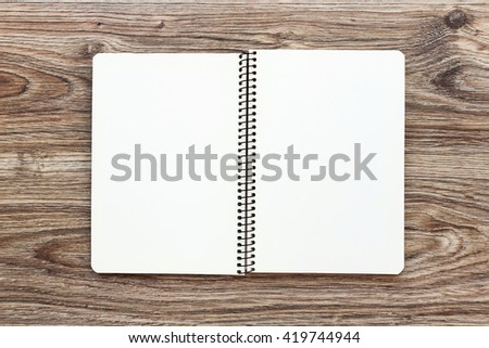 Mockup of open notepad with blank pages on wooden background. Template for your design. Top view. - stock photo